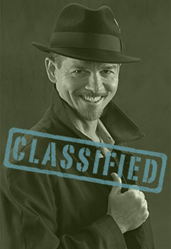 "Photo of Bruce Hale dressed as a spy with ""Classified"" stamped over the photo"