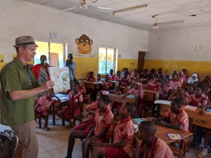 Author Bruce Hale tells stories to Nigerian students